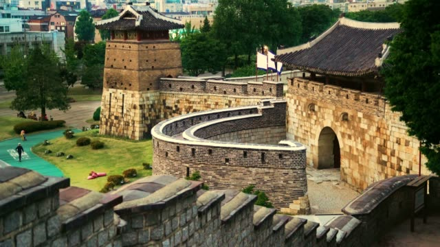 hwaseong is a fortress of the joseon dynasty that surrounds the centre of suwon city - suwon stock videos and b-roll footage