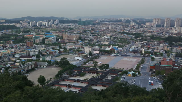 ws t/l hwaseong palace with cityscape of suwon / suwon, suwon, south korea  - hwaseong palace stock videos and b-roll footage