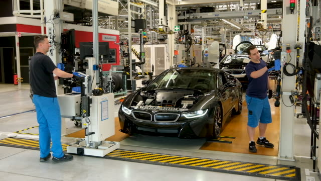i8 hybrid car stands on the assembly line at the bmw factory on may 20 2019 in leipzig germany german president frankwalter steinmeier later spoke at... - bmw stock videos & royalty-free footage