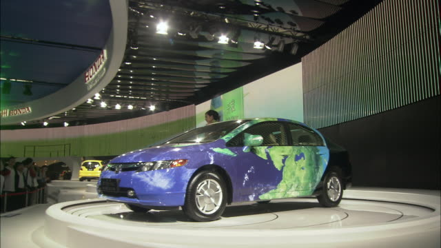 WS Hybrid cars spinning on displays at autoshow, Beijing, China
