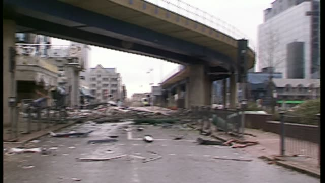 Families of victims granted legal aid to sue alleged bombers LIB London Docklands GV Damage caused by IRA bomb PAN bomb damage