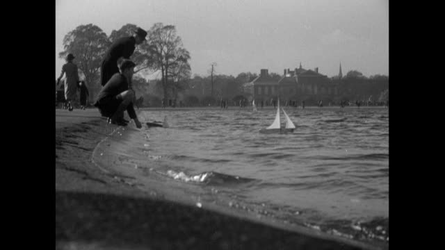 1936 - hyde park, london - kensington palace video stock e b–roll