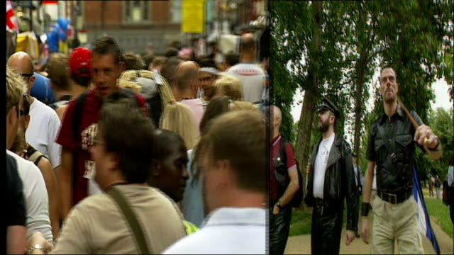 vídeos de stock e filmes b-roll de hyde park sponsored walk for people living with hiv and aids; graphicised sequence split screen crowd celebrating soho pride 2006 / walkers along in... - retrovírus