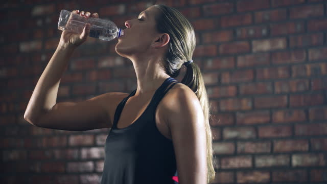 hydration is essential to good health - water bottle stock videos & royalty-free footage