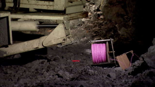 a hydraulic unit retracts on excavation equipment in a mine shaft. - mine shaft stock videos and b-roll footage