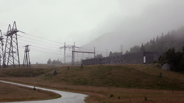 stockvideo's en b-roll-footage met hydro power station in heavy rain - waterkracht