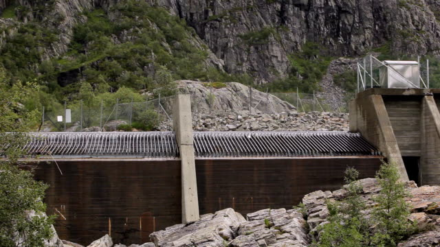hydro power station in mountainside, metal grid and concrete - dam stock videos and b-roll footage