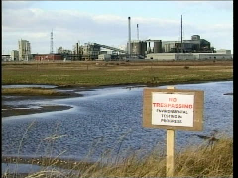 northumbria teeside ext sign by marsh 'no trespassing environmental testing in progress' as ici tioxide europe site seen behind ts investigators... - hydrochloric acid stock videos and b-roll footage