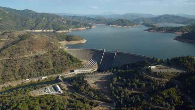 hydroelectric power plant on shasta dam in northern california. - dam stock videos & royalty-free footage