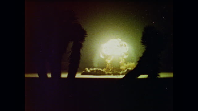 a hydrogen bomb explodes at sunset in the desert - weapons of mass destruction stock videos & royalty-free footage
