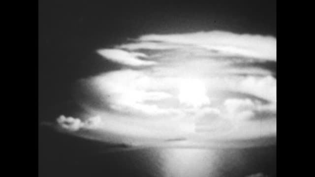 vs hydrogen bomb fiery mushroom cloud explosion / backs of heads of two sailors on deck as they watch look at hbomb / note exact day not known - atomic bomb testing stock videos & royalty-free footage