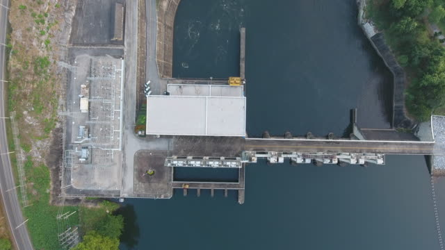 hydropower plant aerial view stock video - hydroelectric power stock videos & royalty-free footage