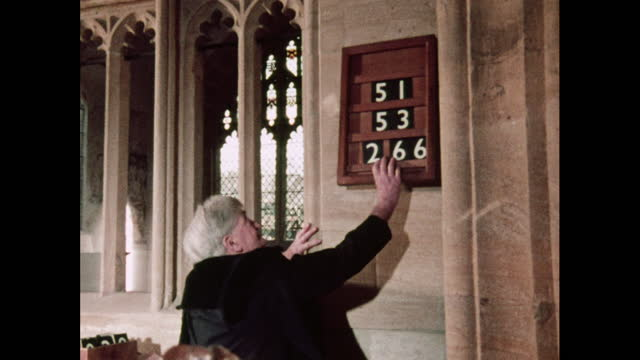 hymn numbers displayed and church bells rung - one senior man only stock videos & royalty-free footage