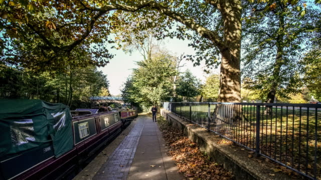 hyper lapse along the regents canal in east london during  autumn. - victoria park london stock videos & royalty-free footage