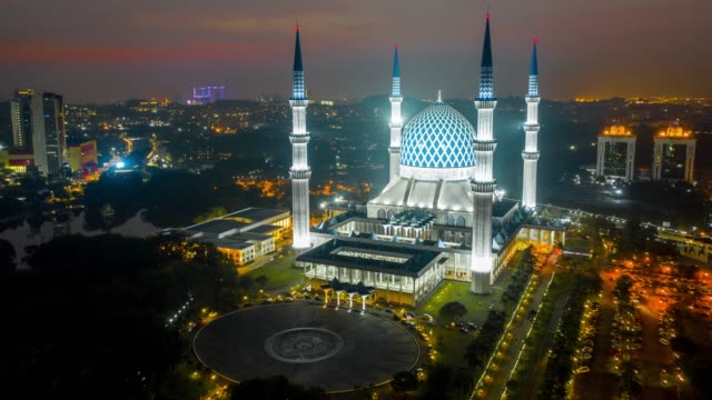 4k hyper lapse by drone fly over blue mosque or sultan salahuddin abdul aziz shah mosque location at selangor near kuala lumpur, malaysia - mosque stock videos & royalty-free footage