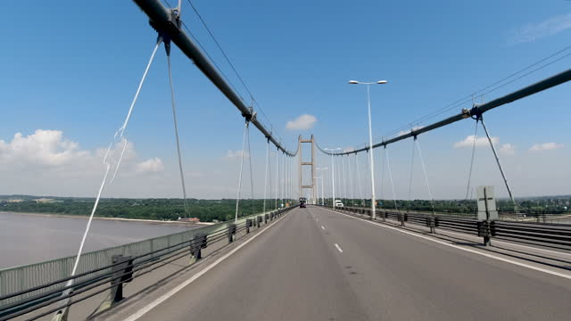 4k hyper lapse pov car crossing the humber bridge spanning the humber estuary in yorkshire, england. road works and maintenance taking place on the humber bridge. - 1 minute or greater stock videos & royalty-free footage