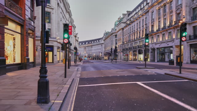 a hyper lapse down regent street to trafalgar square through piccadilly in central london uk,  devoid of people and traffic at dusk - dolly shot stock videos & royalty-free footage