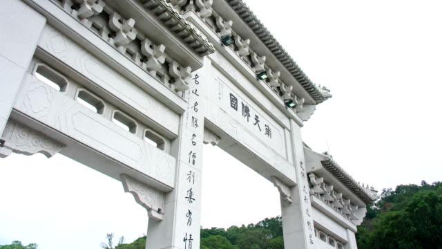 hyper lapse : giant buddha at ngong ping, po lin buddhist monastery lantau island - lantau stock videos and b-roll footage