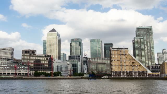 vídeos y material grabado en eventos de stock de london - circa 2013: hyper lapse, hyperlapse, time lapse of canary wharf in london during day by the river, businness buildnigs and banks - 2013