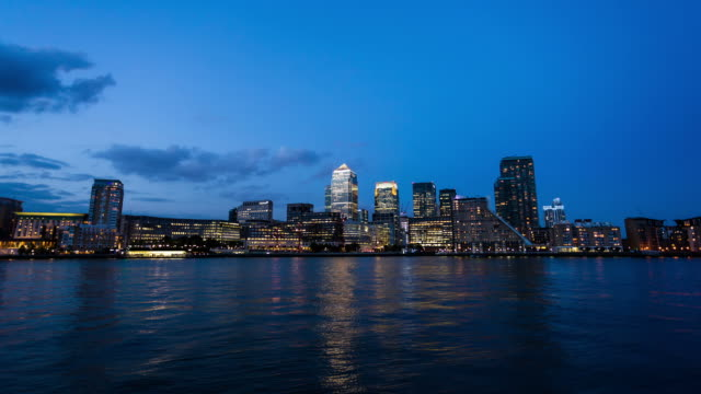 london - circa 2013: hyper lapse, hyperlapse, time lapse of canary wharf in london during night by the river, businness buildnigs and banks - 2013 stock videos & royalty-free footage