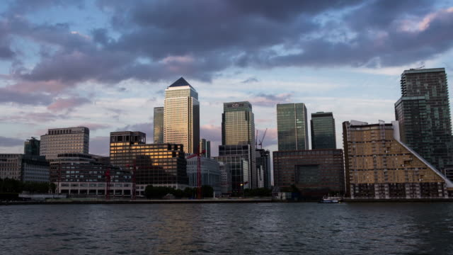 london - circa 2013: hyper lapse, hyperlapse, time lapse of canary wharf in london during sunset by the river, businness buildnigs and banks - 2013 stock videos & royalty-free footage