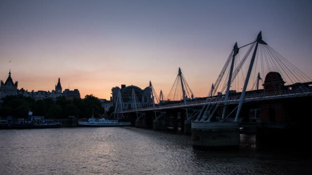 LONDON - CIRCA 2013: Hyper Lapse, hyperlapse, time lapse of Embankment Bridge during sunset by the river Thames in a sunny day