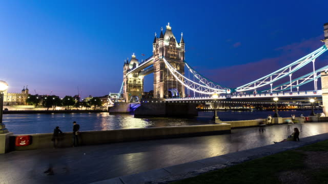 london - circa 2013: hyper lapse, hyperlapse, time lapse of tower bridge opening twice during the night with people walking   - tower bridge stock videos & royalty-free footage