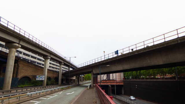 hyper lapse of a train line and highway in london - hyperlapse video stock e b–roll