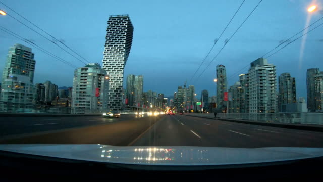 hyper lapse of driving through downtown vancouver - car point of view stock videos and b-roll footage