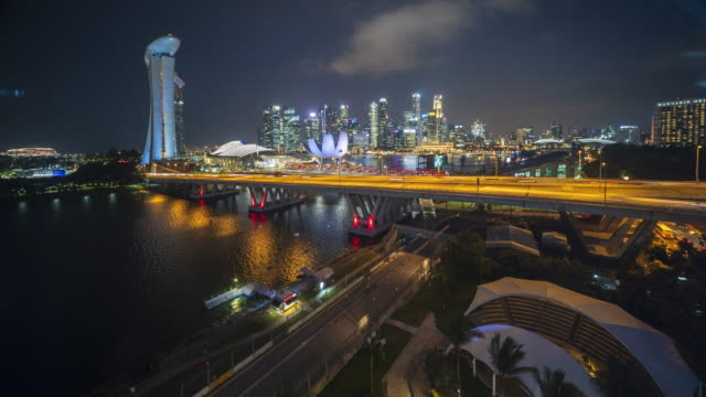 Hyper lapse panoramic aerial view of Marina bay and Singapore city in twilight Singapore