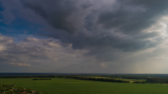 Hyper lapse panoramic aerial view of thunderclouds over the field