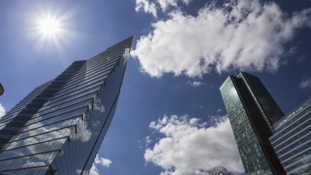 Hyper lapse / time lapse along corporate buildings in financial / business district La Défense in Paris