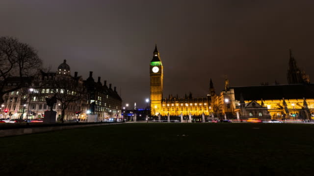 london - circa 2013: hyper lapse - time lapse  movement,  westminster and big ben by night, with traffic and clouds in london. - 2013 stock videos & royalty-free footage