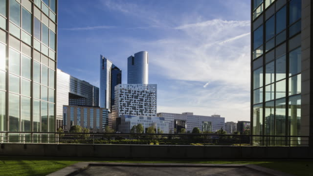 Hyper lapse / time lapse of corporate buildings in financial / business district La Défense in Paris