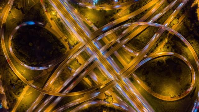 4k hyper lapse : traffic on highway interchange - aerial view of expressway or freeway  road junctions - headlight stock videos & royalty-free footage