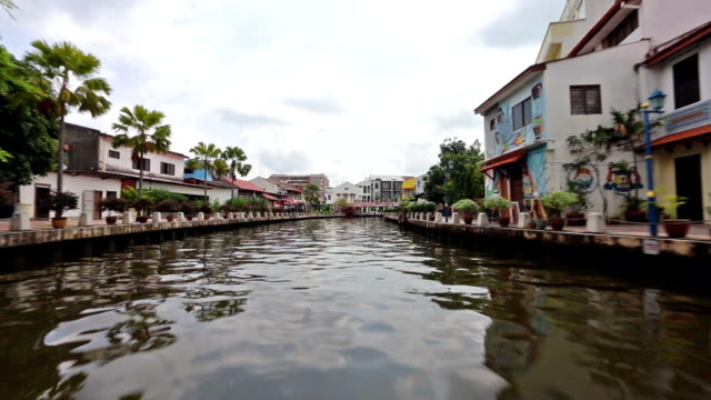 hyper lapse video of a boat along the river in melaka in malaysia - malacca stock videos and b-roll footage