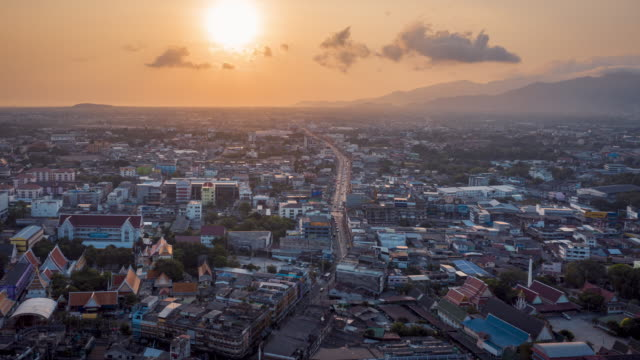hyper lapse video of sunrise cityscape of chonburi, thailand - chonburi province stock videos & royalty-free footage