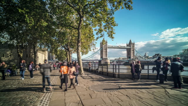 hyper lapse walk along the thames towards tower bridge,  past the tower of london. - city break stock videos & royalty-free footage
