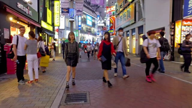 hyper lapse walk in the streets of shibuya in tokyo, japan - pedestrian zone stock videos & royalty-free footage