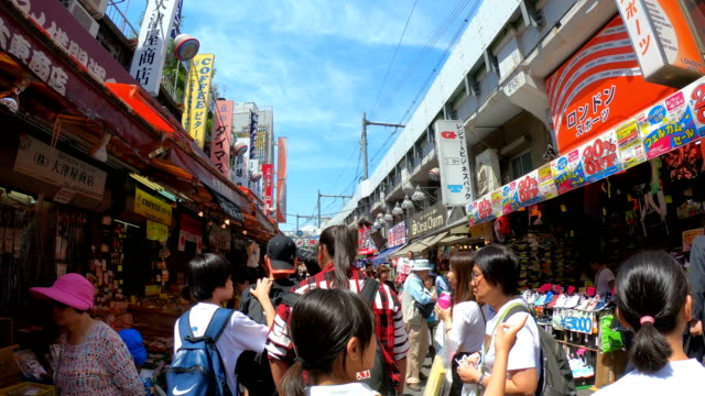 4k hyper lapse walking in meyoko market ueno tokyo, japan. - digital composite stock videos & royalty-free footage