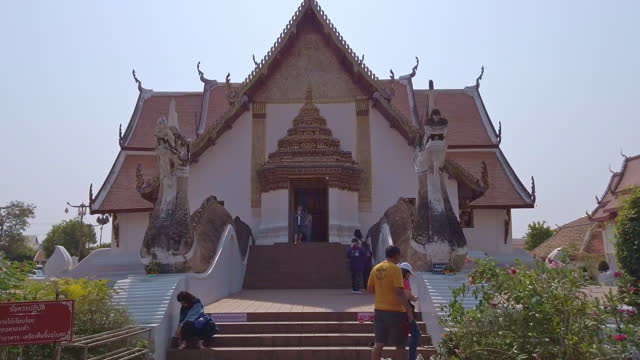 hyper lapse with dolly shot at the entrance of wat phumin, nan province, thailand. - fast motion stock videos & royalty-free footage