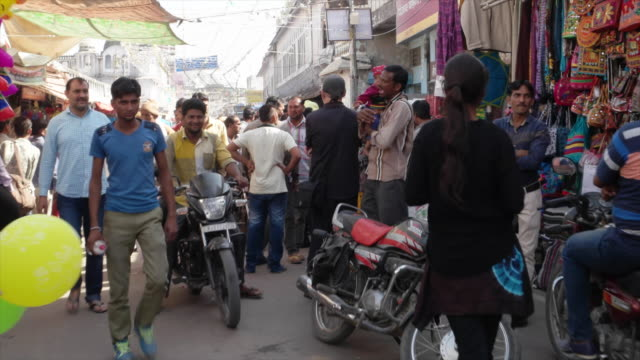 hyper time lapse of the main bazaar market at pushkar mela festival with vibrant folk music and dances horse and camel races religious bathing and a... - temple street market stock videos and b-roll footage