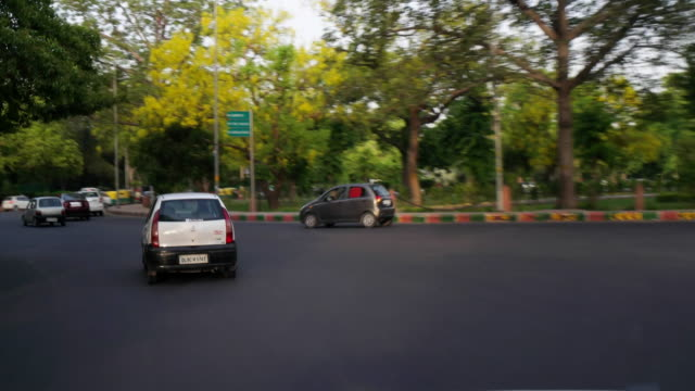 A hyper time lapse pov of a car's driver through the green environment of Lutyens Bungalow Zone in New Delhi