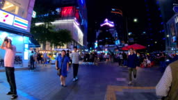 Hyper Timelapse at Myeong-dong Market.People walking on a shopping street at night, Seoul, South Korea