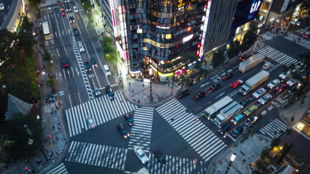 hyper time-lapse of ginza cross - population explosion stock videos & royalty-free footage
