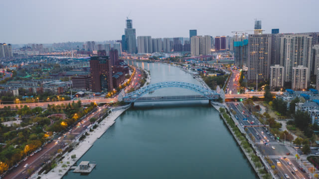 hyperlapse aerial view of bridge over the river - tianjin stock videos & royalty-free footage