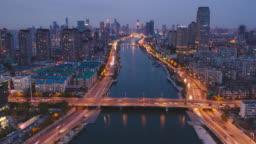 Hyperlapse aerial view of bridge over the river