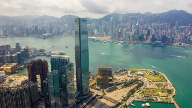 hyperlapse aerial view of cityscape downtown traffic in victoria harbour at hong kong china - victoria peak stock videos & royalty-free footage