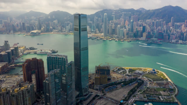 hyperlapse aerial view of cityscape downtown traffic in victoria harbour at hong kong china - victoria harbour hong kong stock videos & royalty-free footage