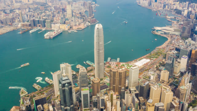 hyperlapse aerial view of cityscape downtown traffic in victoria harbour at hong kong china - hyper lapse stock videos & royalty-free footage